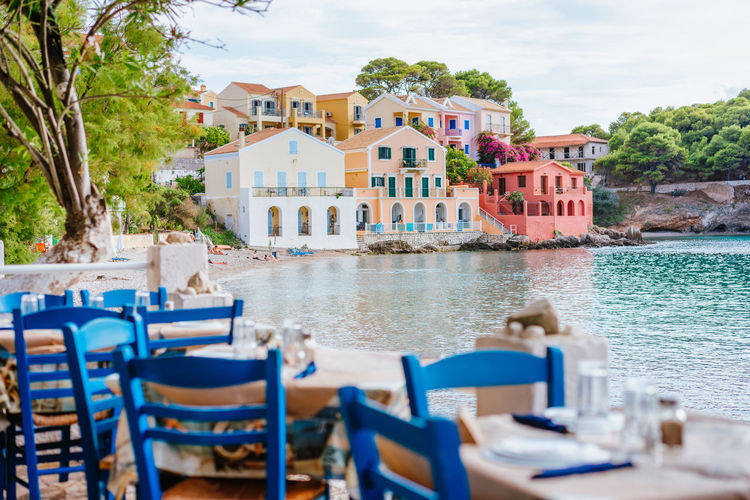 Colorful houses by beach during sunny day