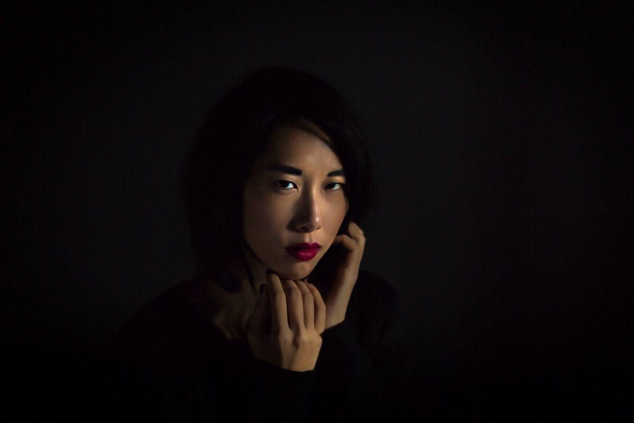 Portrait of beautiful woman touching face