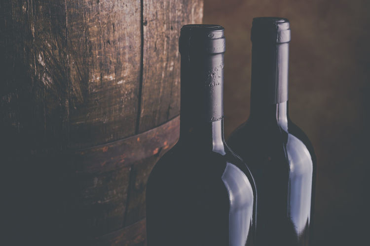 Close-up of red wine bottles