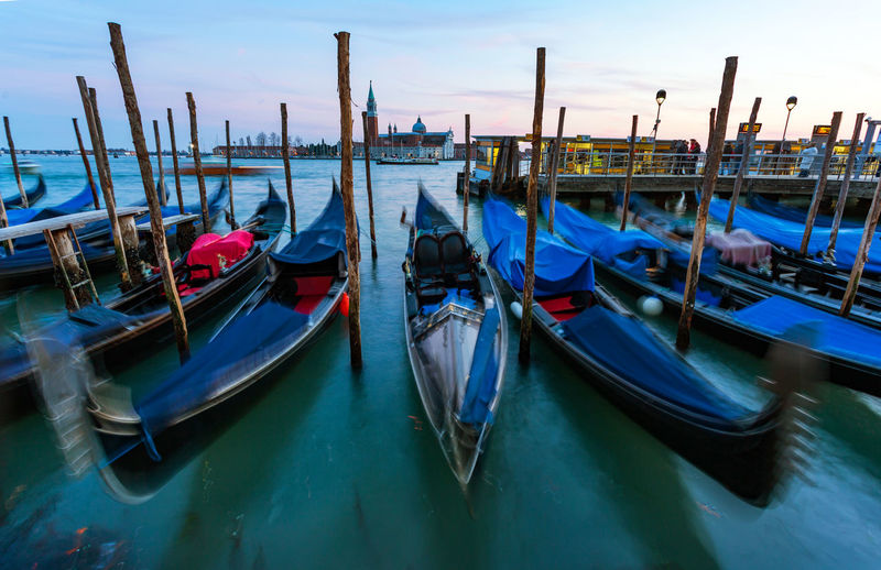 Gondolas Moored In Water