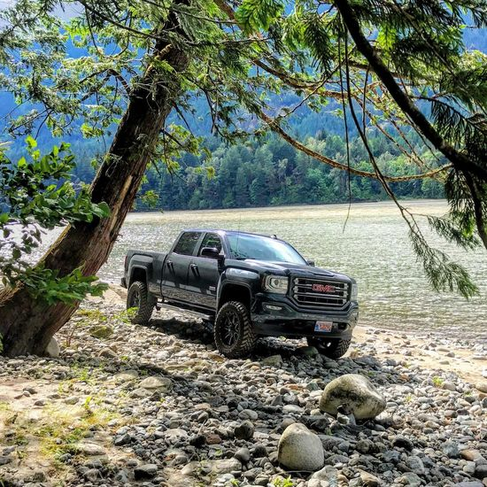 Like a tuff. Frame It! 4x4 On The River Bank  Pickup Truck GMC