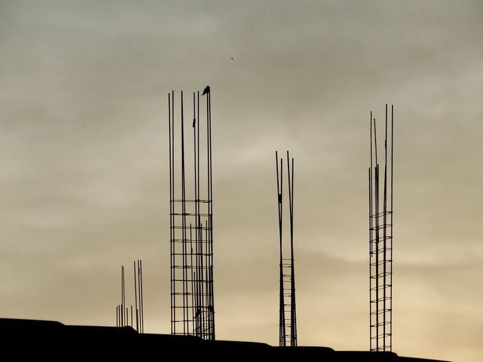 Silhouette Construction Site Against Sky At Sunset