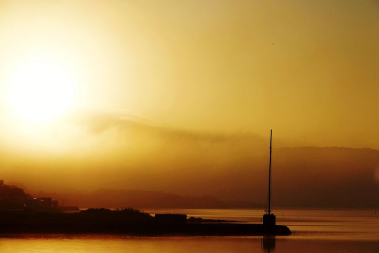 the golden hour Lagoon No People Water Sunset City Sea Silhouette Fog Sky Refraction