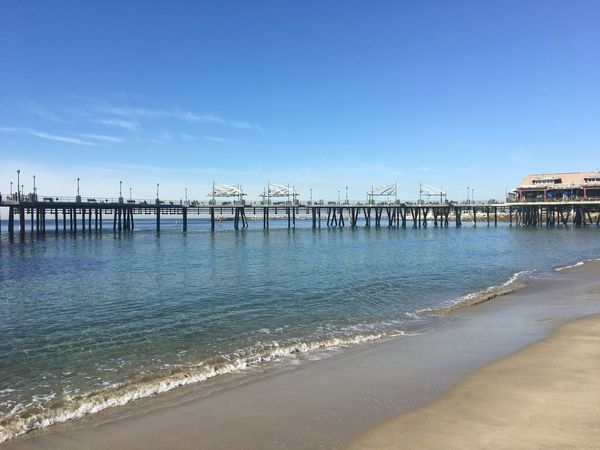 Water Sea Beach Built Structure Pier Architecture Sky Day Tranquil Scene No People Travel Destinations Clear Sky Nature Building Exterior Sand Outdoors Tranquility Beauty In Nature Blue Scenics