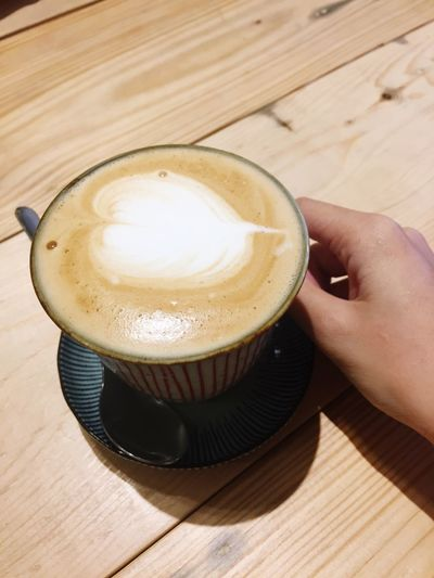 Food And Drink Human Hand Drink Table Human Body Part Frothy Drink Wood - Material Coffee - Drink Refreshment Freshness Coffee Cup Indoors  Food Froth Art Close-up Cappuccino High Angle View One Person Latte Healthy Eating