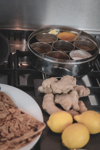 A selection of ingredients and food items at a kitchen - Indian cuisine. Food And Drink Food Freshness Indoors  Healthy Eating Preparation  Container No People Bowl Preparing Food Still Life Domestic Room Raw Food Wellbeing Ingredient Kitchen Close-up Household Equipment Kitchen Utensil Large Group Of Objects Chopped Indian Cuisine Curry