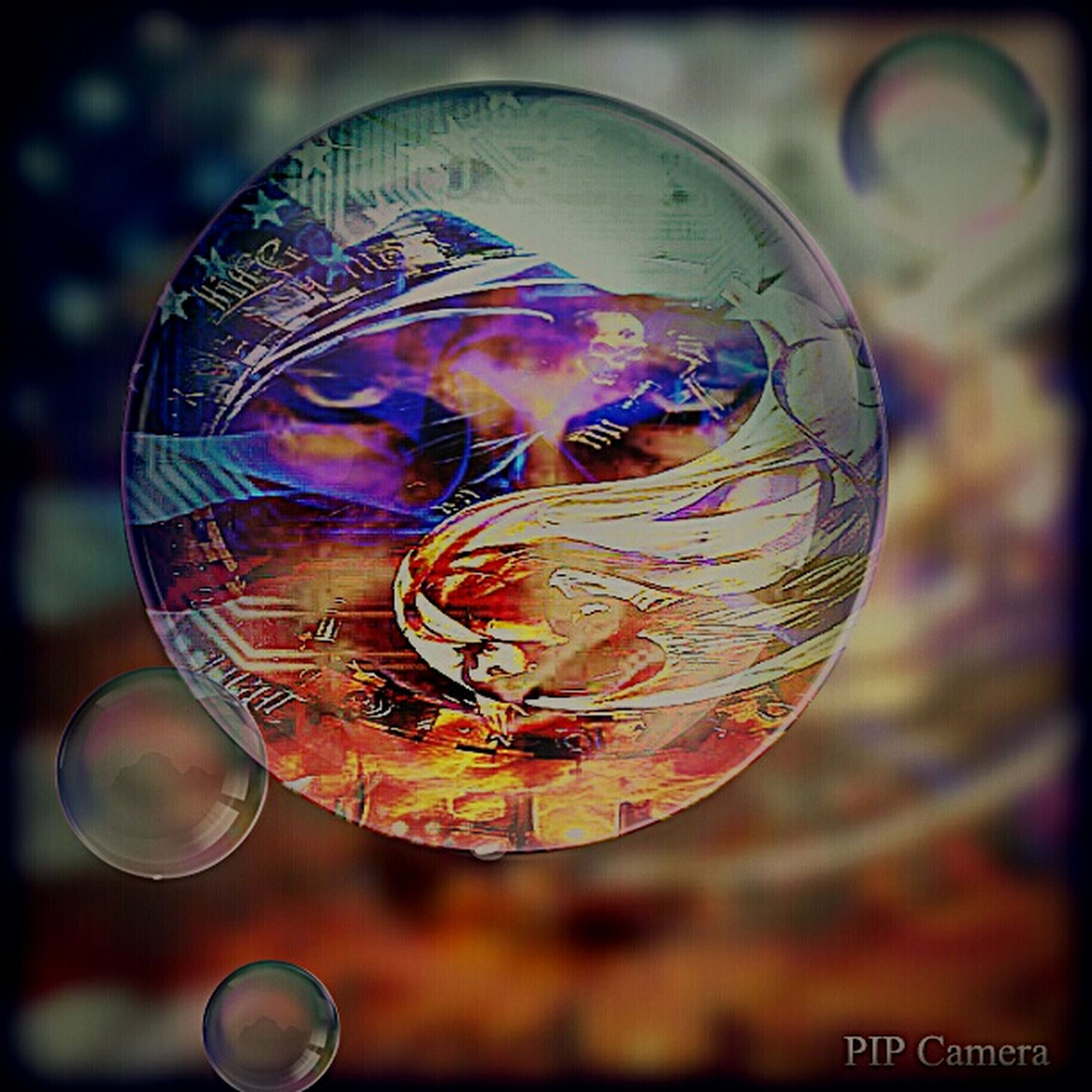 close-up, art and craft, creativity, art, focus on foreground, human representation, circle, night, indoors, ideas, text, communication, auto post production filter, illuminated, sphere, western script, arts culture and entertainment, no people