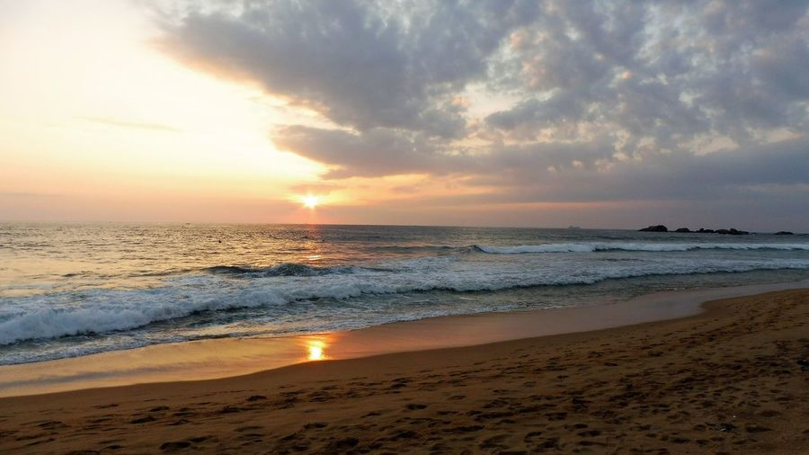 Sri Lanka Beach Beauty In Nature Cloud - Sky Horizon Over Water Nature No People Outdoors Sand Scenics Sea Shore Sky Sun Sunset Tranquility Water Wave