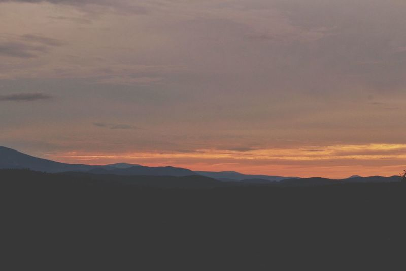 Silhouette of mountain range at sunset