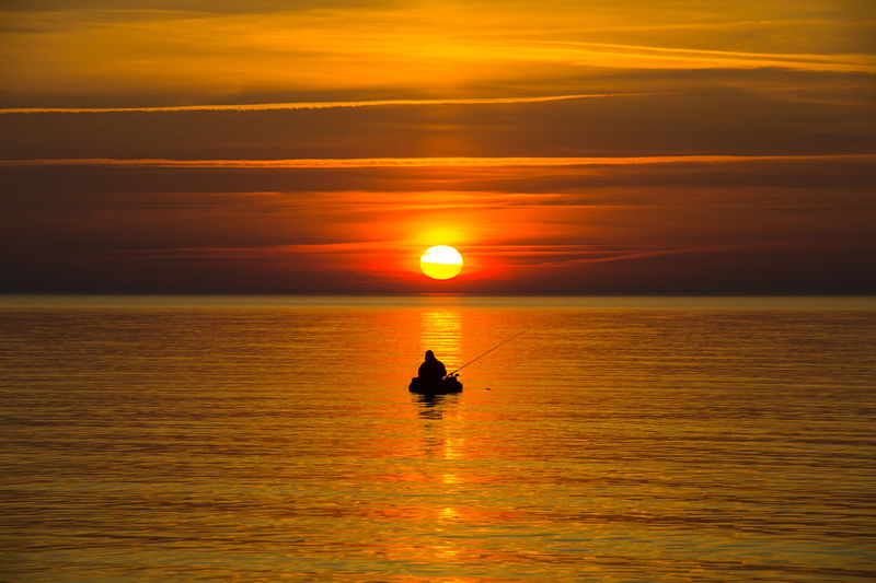 Atmosphere Beauty In Nature Boat Horizon Over Water Idyllic Journey Mode Of Transport Nature Nautical Vessel Non-urban Scene Orange Color Reflection Rippled Scenics Sea Silhouette Sky Sun Sunset Tranquil Scene Tranquility Transportation Vacations Water Waterfront