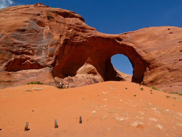 Horses Lost In The Landscape Monument Valley Beauty In Nature Riders Rock Formation Scenics Sky Sunlight