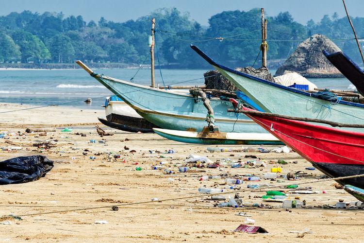 Fishing boats moored at beach