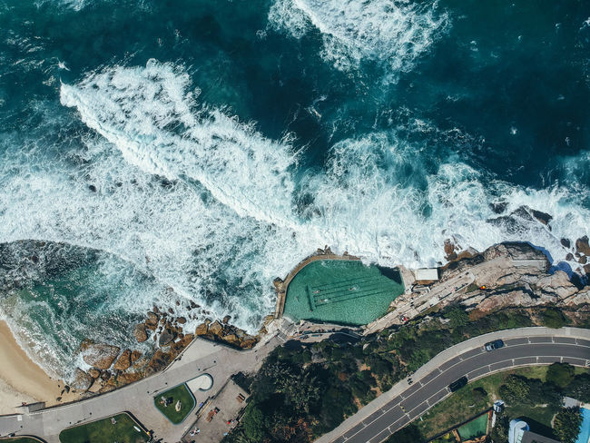 Sydney Australia Drone  Bronte Beach Sea Water Motion High Angle View Built Structure Day Wave Sport Beauty In Nature Turquoise Colored Breaking Power In Nature Outdoors City Beach Aquatic Sport