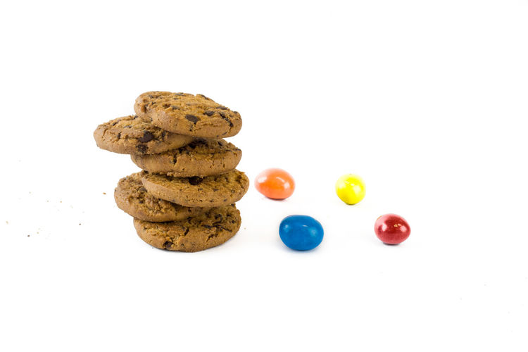 Close-up of cookies against white background