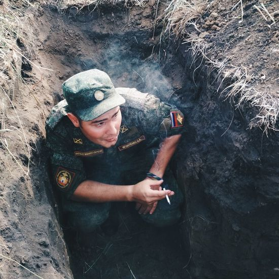 High Angle View Of Soldier Smoking Cigarette