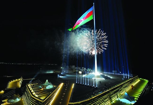 """One of the highest flag of the world is Azerbaijani flag fluttering in the square of the National Flag in Baku. Organization of the world records """"Guinness"""" has affirmed in May 29, 2010 that the highest flag pillar of the world is state flag of Azerbaijan. The National Emblem of Republic of Azerbaijan, the text of the National Anthem and the Map of the country, which were installed at square, have been prepared from bronze in gilded water. Museum of the National flag has been created in the square, too. Foundation of the square of the National flag has been laid at Bayil settlement of Baku in Dec 30, 2007 near to Naval Base. """"Azenko"""" company of Azerbaijan had executed the project prepared by """"Trident Support"""" company of the United States of America.  The height of the constructed pillar is 162, the diameter of the foundations is 3,2, the diameter of the top of the foundation is 1,09 meters. Total weight of the device is 220 tons. The width of the flag is 35 meter, the length is 70 meters, the total area is 2450 sq.meters, and the mass is approximately is 350 kg. The weight of the flag increases twice in wet conditions. About 28 millions river rocks brought from many regions of the country were used in the construction of the wall of the pedestal of the pillar at which the tricolor flag flutters and the walls of the castle were created symbolically at surroundings of the flag. Inauguration of square of the National flag and solemn hoisting of the National flag had been implemented in September 1, 2010. 10 millions manat had been allocated to the Baku City Executive Authority from Presidential Fund included in the state budget of Republic of Azerbaijan for 2009 for purposes of construction-installation and accomplishment works in the square of National flag located in Baku city. Land Of Fire Flag Square Flag Azerbaijan Flag Relaxing Azerbaijan"""
