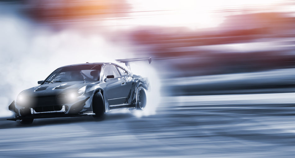 Smoke Speed Tracking Transportation Auto Racing Blurred Motion Car Cat Competition Competitive Sport Driftwood Headlight Land Vehicle Motion Motorsport No People Outdoors Racecar Speed Sport Sports Sports Race Sports Track Stop Action Transportation