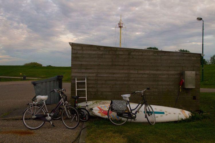 Surfing? Bicycle Sky Architecture Cloud - Sky Built Structure Transportation Outdoors Day No People Building Exterior Surfboard Surfboards Zeeuws Vlaanderen Schelde