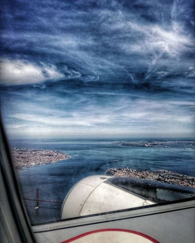 Electric skies of Lisbon Transportation Mode Of Transport Cloud - Sky Sky Aerial View Sea Travel Airplane Window Air Vehicle Landscape Scenics