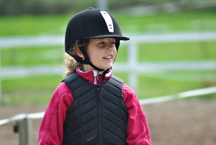 Smiling cute girl wearing sports clothing