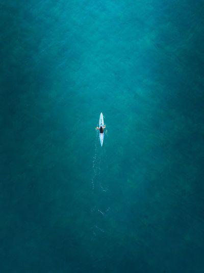 Aerial view of man kayaking in sea