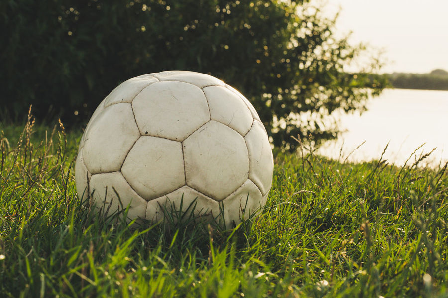 Ball Childhood Childhood Memories Close-up Day Focus On Foreground Football Free Time Freedom Grass Grass Kids Laisure Nature No People Outdoors Soccer Soccer Ball Soccer Field Sport Sunny