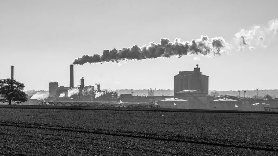 Black and white panoramic view of the Sugar Beet Factory, Bury St Edmunds, Suffolk. Sugar Beet Factory Sugar Beet Building Exterior Pollution Smoke - Physical Structure Factory Built Structure Industry Panoramic Landscape Panoramic Beet Factory Sugar Beet Factory Black And White Photography Black And White Sky Black And White Panoramic