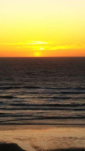 Sunset Sea Nature Yellow Horizon Tranquility Beauty In Nature Beach Sun Opportunity Scenics No People Water Horizon Over Water Outdoors Sunrise Sky