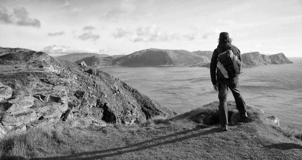 explorer in norway Expedition Exploring Hiking Norway Panoramic View Runde Island Travel Photography B&w Beauty In Nature Full Length Hikingadventures Landscape Leisure Activity Lifestyles Men Mountain Nature North One Person Outdoors People Real People Scenics Sky Wilderness