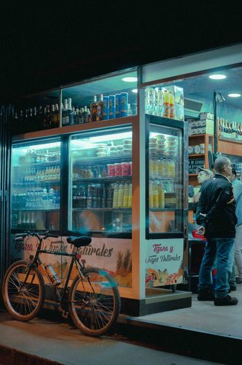 fruit store EyeEm Best Shots EyeEm Selects Architecture Building Exterior Built Structure Choice City Food Fruit Store Full Length Ice Cream Illuminated Indoors  Men Night One Person People Real People Retail  Store Streetphotography Supermarket Variation Vending Machine