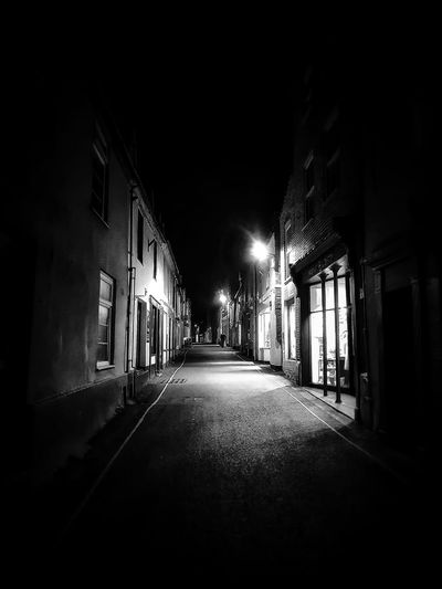 Wells next the sea . side street at night Malephotographerofthemonth Blackandwhite Photography monochrome photography Dark Picture Wells-next-the-Sea Nightphotography City Illuminated Architecture Built Structure vanishing point Diminishing Perspective Passageway The Way Forward Residential Structure Street Light Empty Road Building Spooky