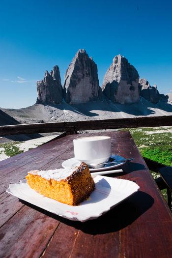 Cake and coffee at the famous tre cime di lavaredo in dolomites