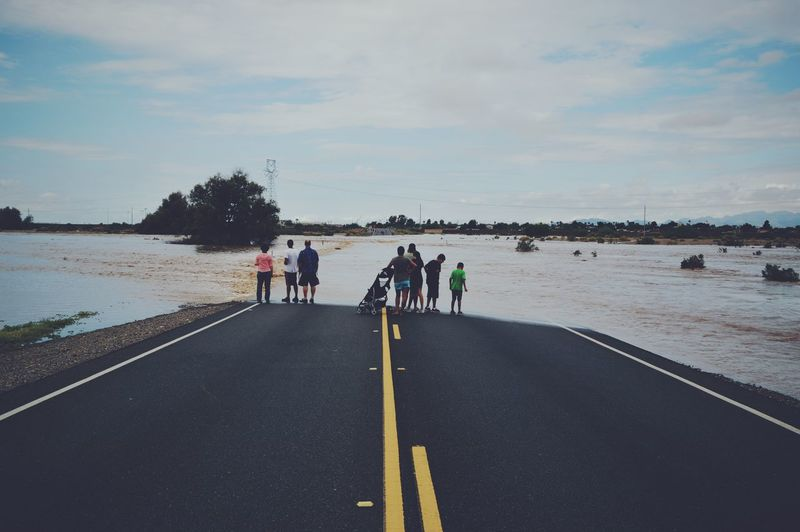 People on flooded highway