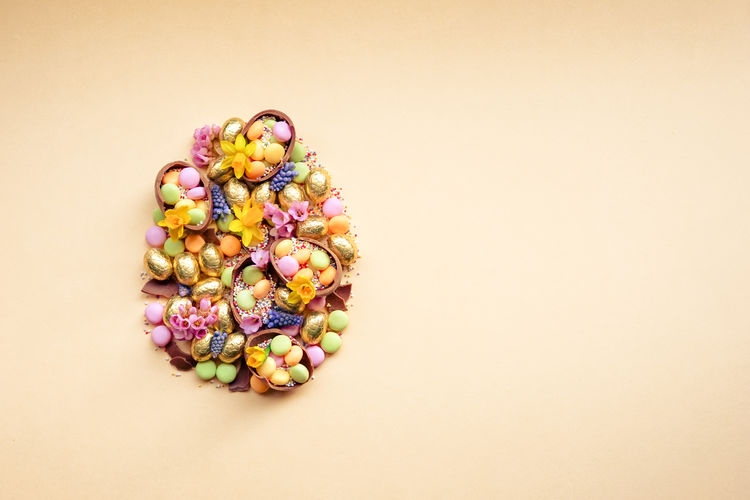 Multi colored candies against white background