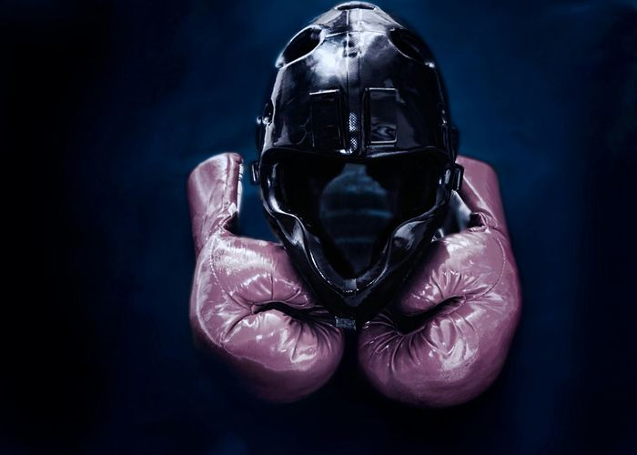 High Angle View Of Boxing Gloves And Helmet On Table