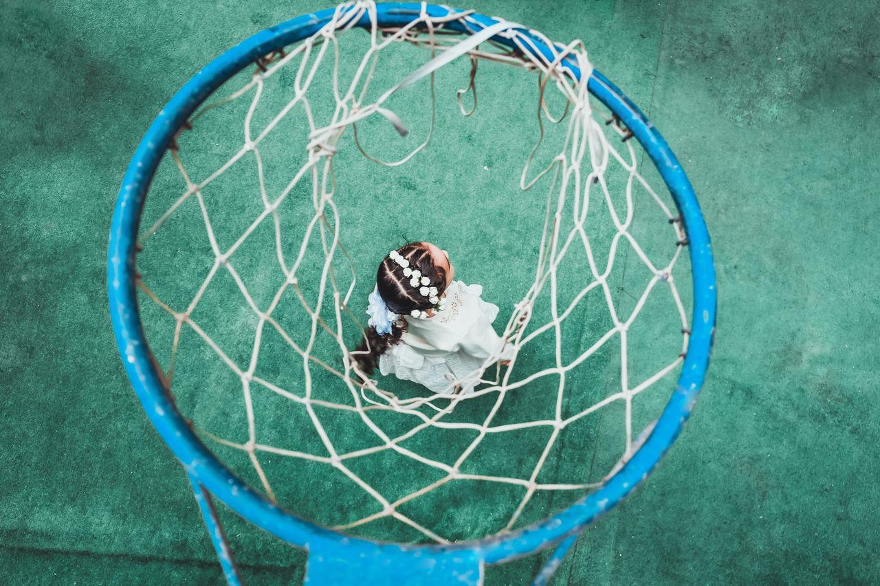 High angle view of girl and basketball hoop