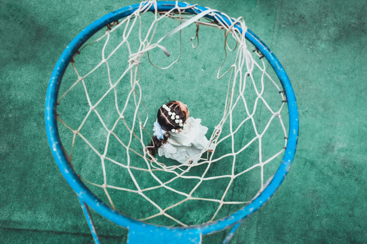 High angle view of girl and basketball hoop