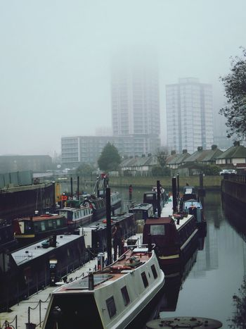 A Man on the Canal talks business on the Phone . I like the transition between Canal Boats , residential Houses and then high rise Flats covered in the Fog in the background. Boat Boats Foggy City Architecture Outdoors Water Canal Boat Canals London Canal Life London Lifestyle East London Bow Stratford Adapted To The City Highrisebuilding EyeEmNewHere