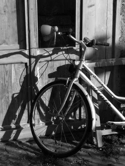 Bicycle parked on street against old building