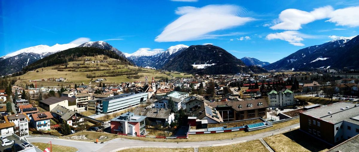 Aerial View Of Townscape By Mountains Against Sky