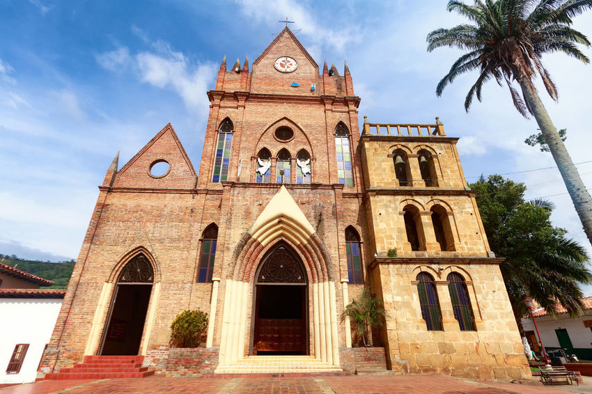 The exterior of the Cabrera Church in Cabrera, Colombia. American Church Colombia Latin South Tourist Travel America Architecture Attraction Cabrera Colombian  Colonial Cundinamarca Destination Historical History Low Angle View Old Outdoors Place Of Worship Religion Spirituality Tourism Tree