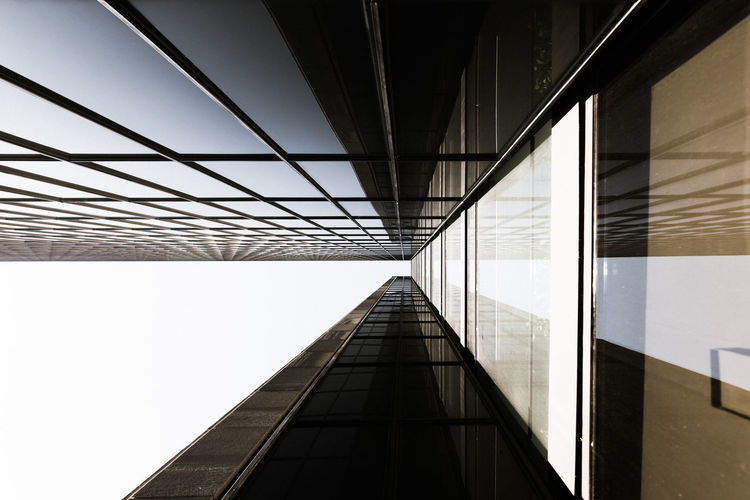 Directly below shot of modern builing  against sky in city