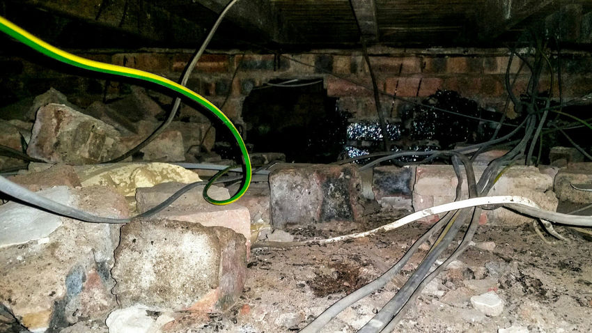 Service Space Utilities Electrical Cables Pipes Water Brickwork  Wall Day Job  Crawl Space Wiring  Horizontal Underground Below Hidden Places Services Floorboards Wires Bricks Colour Image No People House Cavity Home Under