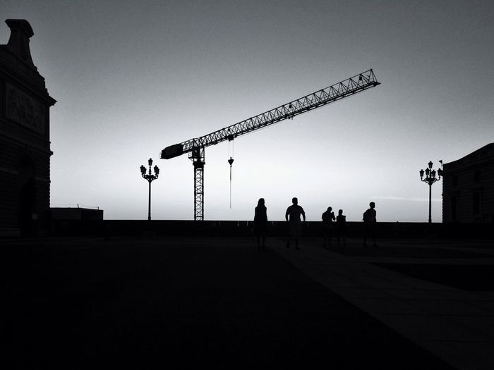 Low angle view of silhouette people against sky