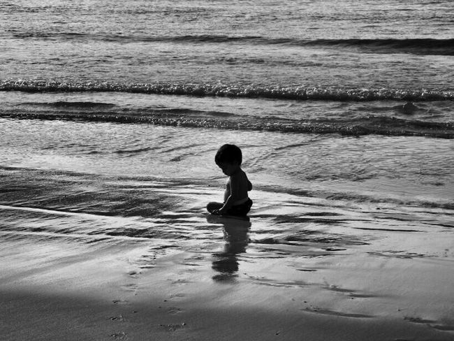 Baby Gael on the beach! 1/2 for the Bnw_friday_eyeemchallenge dont want to be late...will be back after school!! TGIF!!! Water Monochrome Hello World Black And White Photography Black And White Bw_collection Black And White Collection  For The Love Of Black And White Sweet Memories