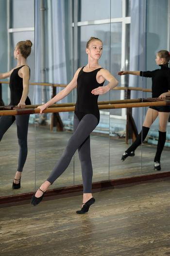 Ballerina Ballet Ballet-girl Barre Caucasian Dance-hall Dancer Girl Practice Practice Practise Rehearsal School Stretch Student Studio Vertical Window Women Young Women