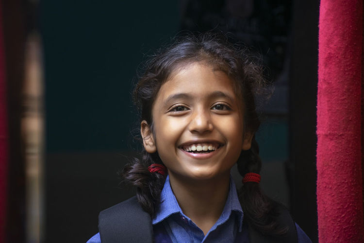 Portrait of smiling girl at home