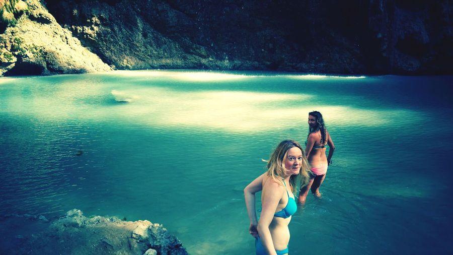 Women Wearing Bikini In River