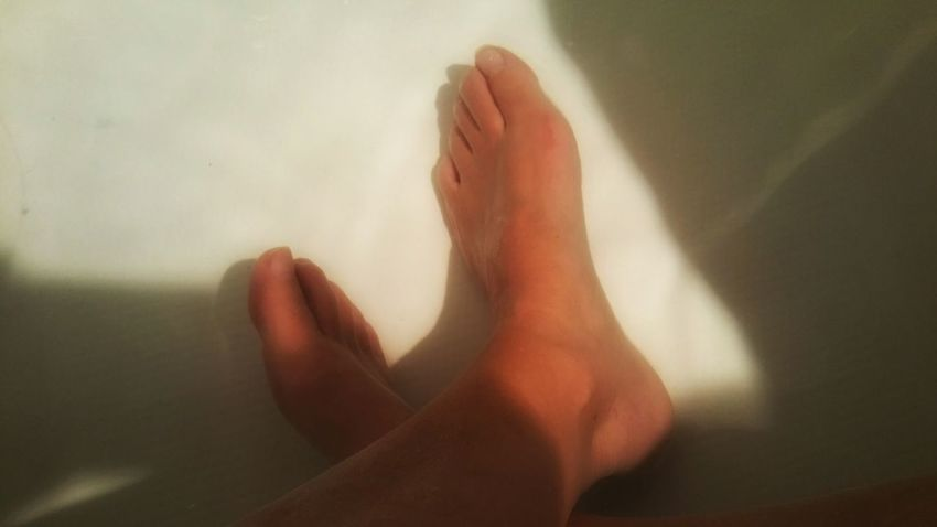 Crossed feet in water. Relaxation. Shadows & Lights Relaxing Simple Minimalism Zen Meditation Spa Ultimate Tub Free Peaceful Low Section Human Leg Water barefoot Shadow Human Foot Close-up Toe Foot Leg Taking A Bath Legs Crossed At Ankle Pedicure Feet Domestic Bathroom Bathtub