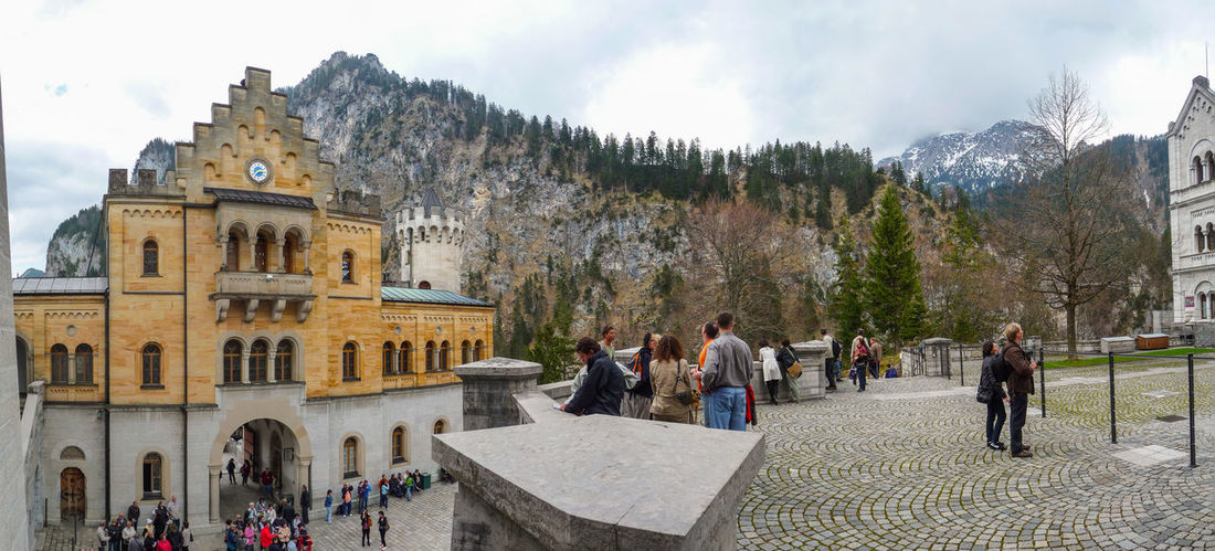 Apr 2010 - Interior plaza of Neuschwanstein Castle Adult Architecture Building Building Exterior Built Structure Cloud - Sky Crowd Day Group Of People History Large Group Of People Lifestyles Men Mountain Nature Outdoors Real People Sky The Past Travel Women